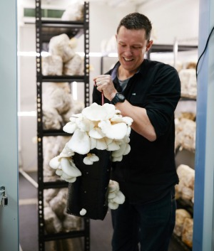 Ryan Sharpley from Benton Rise with some of his mushrooms.