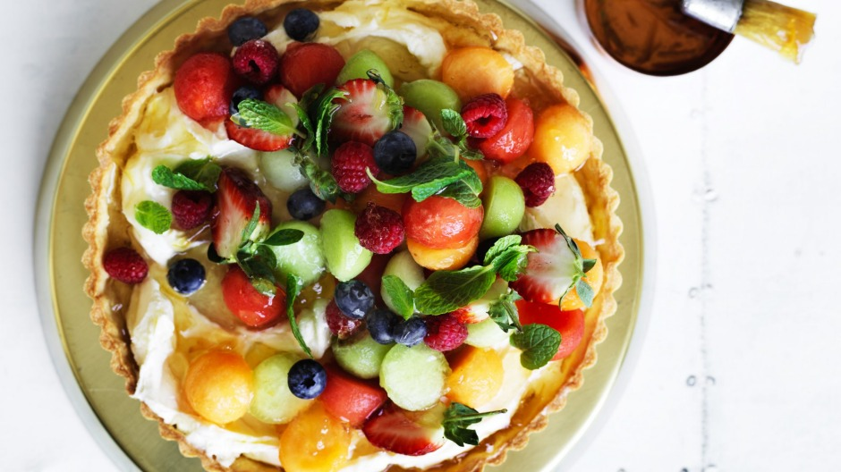 Melon and berry mascarpone tart with marmalade glaze.