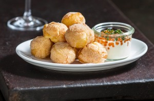Doughnuts with sour cream, salmon roe and chives from Cutler and Co.