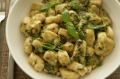 Potato gnocchi with pesto cream.
