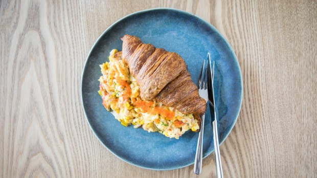 Toasted croissants with soft scrambled eggs, crabmeat and corn.