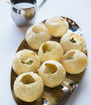 Pani puri puffs with pour-your-own tamarind dressng