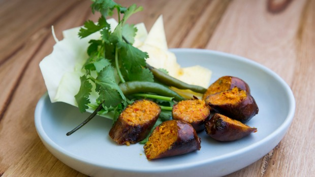 Fermented sausage comes with cabbage leaf, pineapple and pickled green chilli.