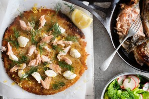 Crispy potato rosti topped with creme fraiche dollops, dill fronds and flaked trout.