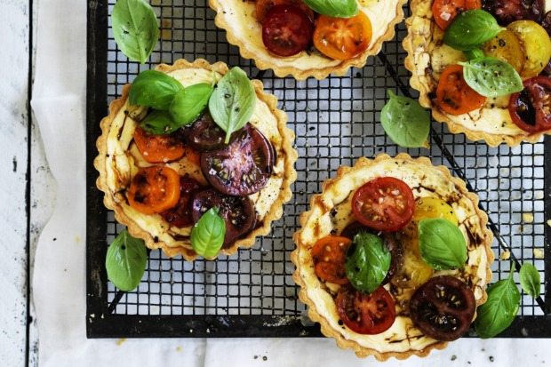 Goat's curd tartlets topped with heirloom tomatoes <a ...