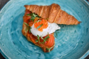 Croissant with cured trout, roe and poached egg.