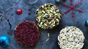 Decorate the Turkish delight rounds with nuts and dried fruit.