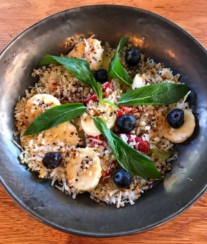 Banana, berries and quinoa salad with kiwi, lime and toasted coconut.