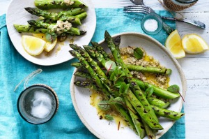 Barbecued asparagus with nutty tarator.