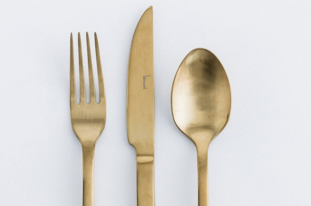 Gold-accented cutlery, $260 for a four-person set (each set includes a dinner fork, knife, spoon, entrée fork and ...