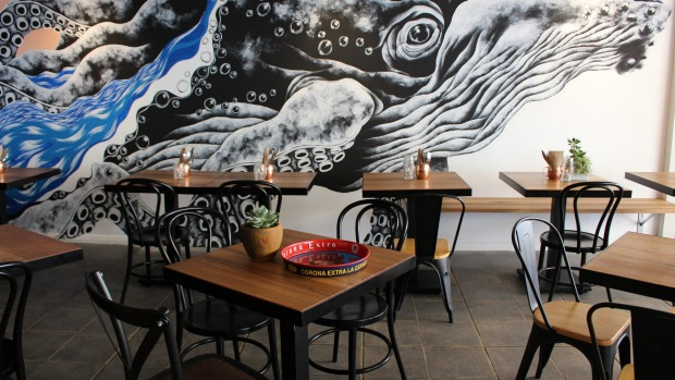 A 'whale-octopus' mural decorates the new venue.
