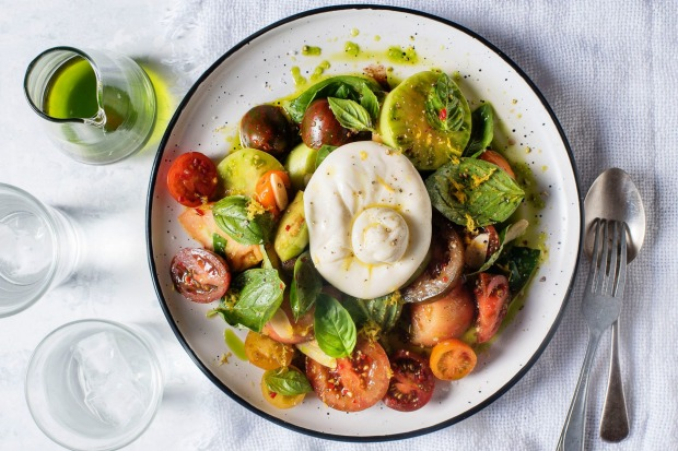 Three Blue Ducks' burrata cheese with heirloom tomatoes and basil oil <a ...