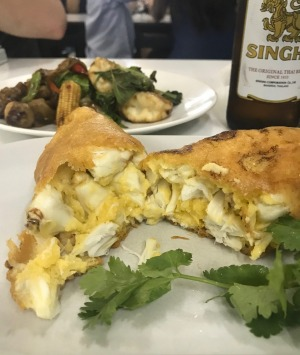 <i>Jay Fai's signature dishes - crab omelette and drunken noodles with prawns.</i>