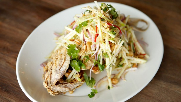 Whole fried snapper with apple salad.