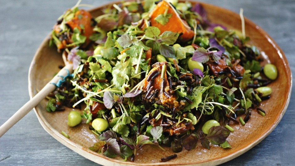 Ginger, miso and sesame dressing with roast pumpkin, wild rice and edamame salad.