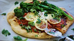 Spicy harissa, broccolini and lemon pizza with cooling whipped feta.