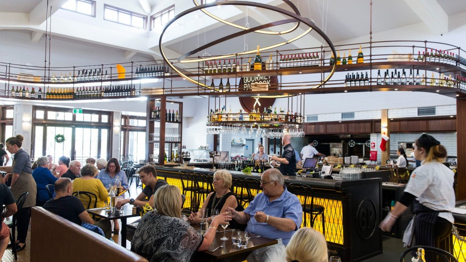 Gourmet Paddock's interior features an elevated wine rack stocked with local drops.