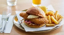 Panko-crumbed fish sandwich with tartare and chips at the newly renovated Transport Bar at Fed Square.