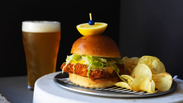 Crispy fish sandwich (crumbed white fish, lettuce, cheese and tartare sauce with potato crisps) at Bondi Beach Public Bar.