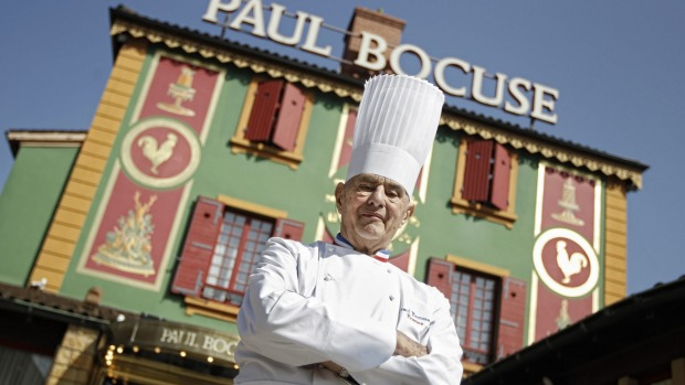 Paul Bocuse poses outside his famed Michelin three-star restaurant L'Auberge du Pont de Collonges in ...