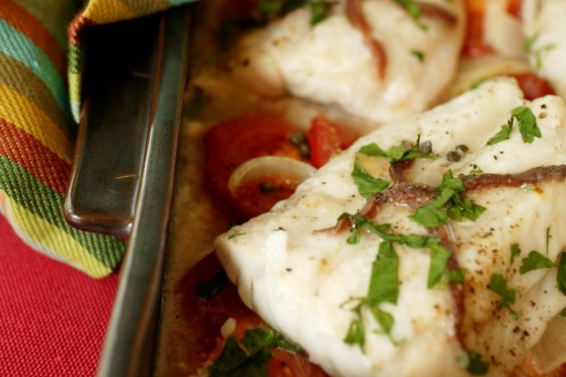 Anchovy-baked fish on a bed of tomato and onion <a ...
