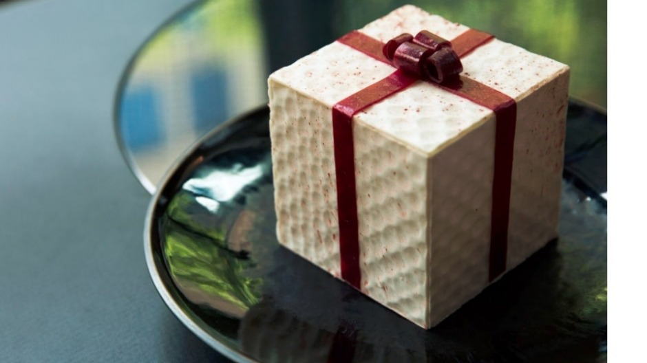 This white chocolate and raspberry 'gift' at QT Melbourne is a dessert with a surprise