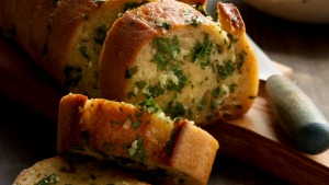 A baguette can easily be transformed into garlic bread.