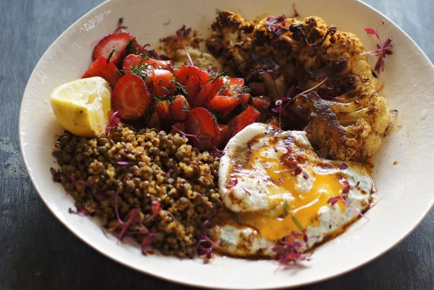 Turkish poached egg, baharat spiced cauliflower, strawberry and tomato loaded hummus and lentil-quinoa salad <a ...