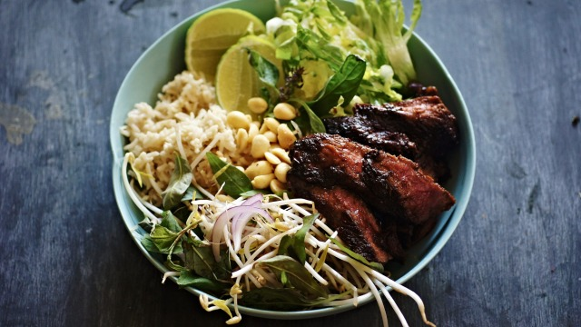 Black pepper and kaffir lime beef bowl with coconut rice and salad.