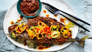 Chermoulas and lime-cured peppers give a kick to this grilled oily fish.