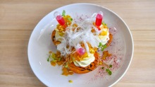 Grilled peaches with puffed rice, truffle honey, cinnamon ricotta, strawberry injectors and fairy floss.