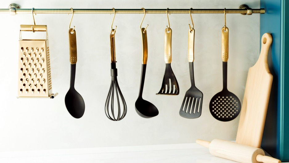Hang utensils (or pots) on a rack, and lean chopping boards against splashbacks.
