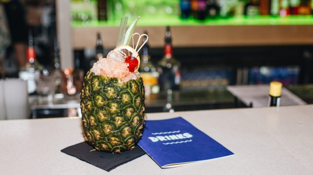 Cocktails include drinks served in coconuts or pineapples.