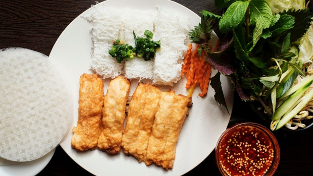 Signature banh hoi chao tom (DIY ricepaper rolls with steamed rice noodle cakes and sugar-cane prawns).