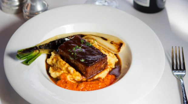 Red wine-braised beef short rib, Anson Mills polenta and roasted torpedo onion at A.R. Valentien, San Diego.