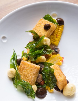 A colourful, composed plate of corn cooked various ways.