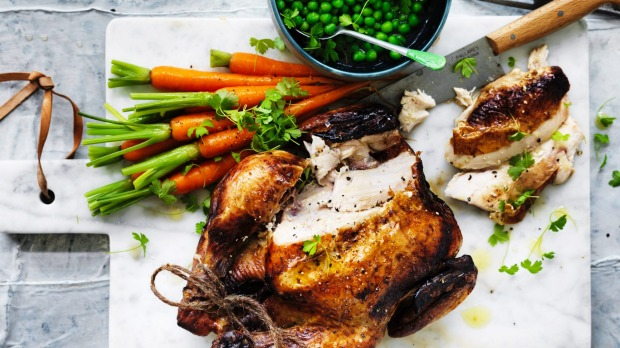 Adam Liaw's classic roast chicken with buttered vegetables.