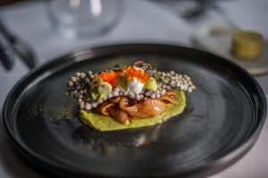 Kingfish escabeche looks like an elegant clam perched atop a bed of avocado puree