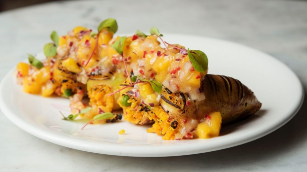 Squid stuffed with spiced chorizo paella and topped with mango salsa.