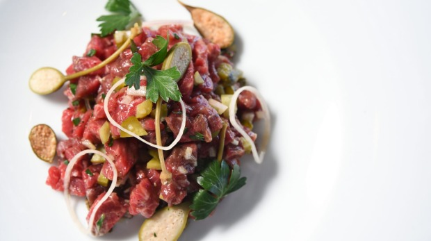 Steak tartare with Sher Wagyu beef, confit egg yolk and condiments.