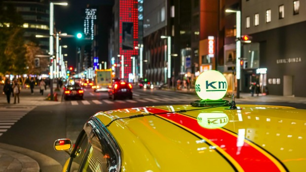 A taxi in a Ginza street at night in Tokyo.