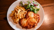 Served with chips (never fries) and a piquant salad, a good 'parmi' is a thing of beauty.