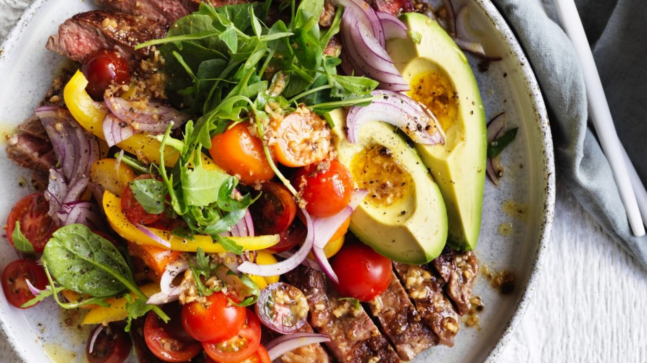 Steak and avocado salad with fried garlic vinaigrette recipe good food theres no need to turn your nose up at salad for dinner forumfinder Choice Image