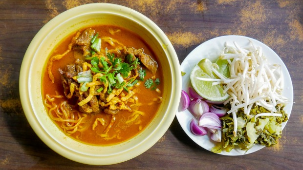 Khao soi curried noodle soup with chicken, a popular northern Thai dish.