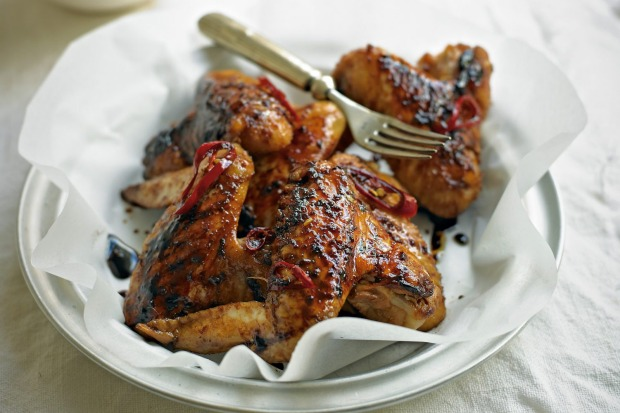 These Asian-style chicken wings are poached, then barbecued <a ...