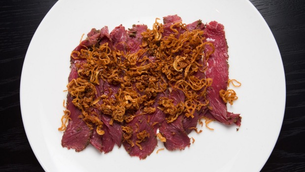 Kangaroo pastrami, cultured cream and crisp onions.