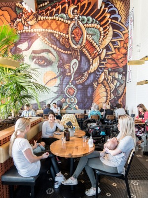 This bright mural also features on the takeaway coffee cups.