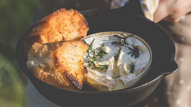 Campfire-baked camembert makes a tasty snack.