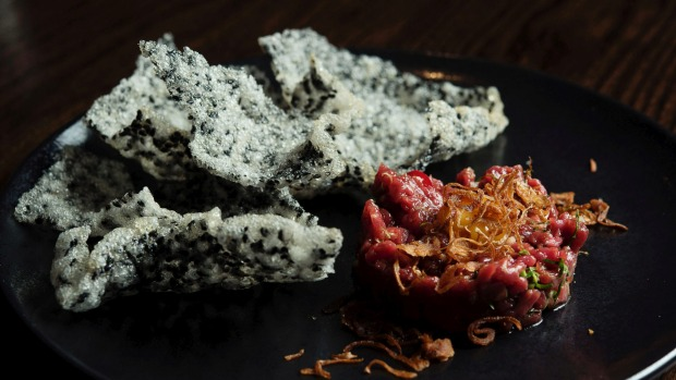 Hand-cut Cape Grim beef tartare with black sesame crackers.