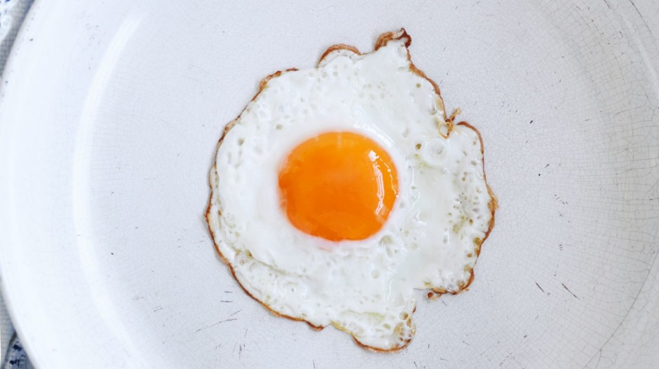 It's a perfect lacy-edged fried egg - but those tiny cracks in the pan's surface could cause it to stick.